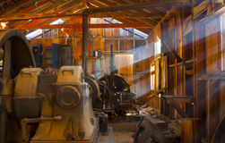 Rustic Mining Shack. Old Miners shack with rustic interior and old mining equipment Royalty Free Stock Photography