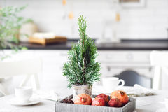 Rustic modern christmas served table with fruits and cup of tea. New Year  table for dinner Stock Photo
