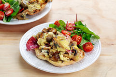 Rustic Morning Breakfast, toast with mushrooms, cheese omelette and fresh vegetables Royalty Free Stock Photography