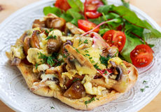 Rustic Morning Breakfast, toast with mushrooms, cheese omelette and fresh vegetables Stock Image