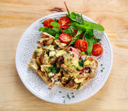 Rustic Morning Breakfast, toast with mushrooms, cheese omelette and fresh vegetables Royalty Free Stock Photo