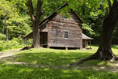 Rustic Mountain Cabin. A view of a historic old wooden cabin in the woods in a peaceful quiet rural location in the Smoky Mountains in mountains Stock Images