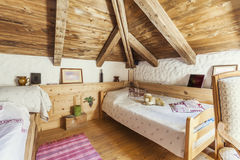 Rustic mountain house bedroom interior Stock Images