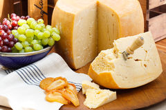 Delicious cheese platter and fruit Royalty Free Stock Photo