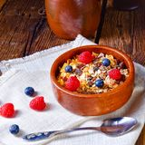 Rustic muesli breakfast with forest fruits Royalty Free Stock Photos