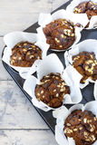Rustic muffins with pumpkin chocolate and oat flakes on baking tray Royalty Free Stock Images