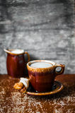 Rustic mug of coffee on wooden background Royalty Free Stock Photography