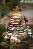 Rustic `Naked` Wedding Cake. With 4 different flavors Stock Photos