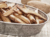 Rustic natural cut french fries Stock Photos
