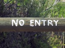 No Entry Sign on Old Log Stock Photography