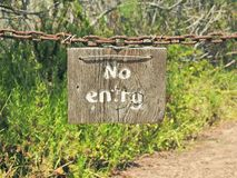No Entry Sign on Rusty Chain Royalty Free Stock Photography