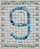 Rustic Number Nine Mosaic. A Rustic Mosaic Of Tiles Showing The Number Nine Stock Image