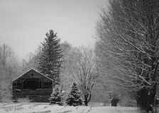 A rustic old barn after a snowstorm stock photography