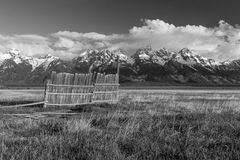 Rustic old black and white field and fence. Royalty Free Stock Photos