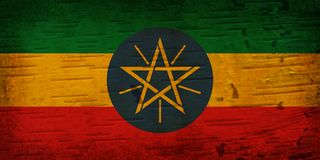 A rustic old Ethiopia flag on weathered wood stock photography