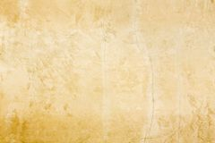 Rustic old European classical style gold stucco wall patina background texture