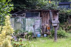 Rustic old garden shed in typical German Garden Stock Image