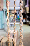 Rustic old grunge chains link in old factory Royalty Free Stock Photo