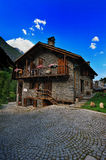 Rustic, old house in Alpine village with blue sky Stock Photo