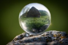 Rustic house in crystal ball