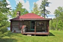 Rustic old log cabin located in Childwold, New York, United States. Rustic old traditional original log cabin located in Childwold, New York, United States on stock photos