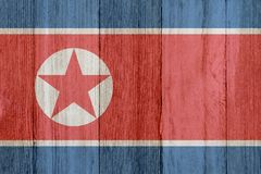 A rustic old North Korean flag on weathered wood stock photo