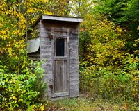 Rustic old outhouse royalty free stock photography