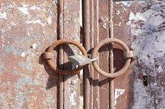 Rustic old padlock on metal door Stock Photography