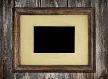 Rustic Old Picture Frame. Old wooden picture frame on wooden wall Stock Photography
