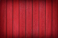 Rustic old red wood plank background with vignette. Rustic old weathered red wood plank background with vignette royalty free stock photo