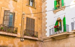 Old mediterranean houses, detail view. Rustic old and renovated mediterranean houses with balcony and window shutters, detail view royalty free stock photo
