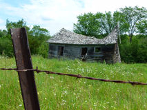 Rustic old shed in field Royalty Free Stock Photo