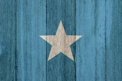 A rustic old Somalian flag on weathered wood. For a background stock photos