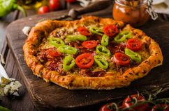 Rustic old style vintage pizza royalty free stock photo