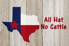 A rustic old Texan saying. Texas map on weathered wood background with text All Hat No Cattle stock images