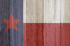 A rustic old Texas flag on weathered wood. For a background stock photos
