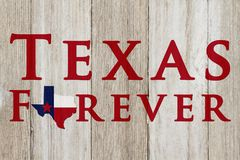 A rustic old Texas Forever message. Texas flag on weathered wood background with text Text Forever stock images