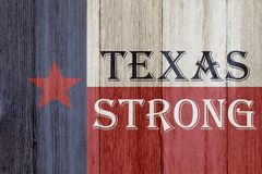 A rustic old Texas Strong message. Texas flag on weathered wood background with text Text Strong royalty free stock image
