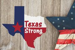 A rustic old Texas Strong message. Texas flag in shape of map with American star on weathered wood background with text Text Strong royalty free stock photos