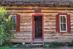 Rustic Old Time Log Cabin Front Door and Windows. Authentic log cabin circa 1800s royalty free stock photography