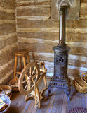 Rustic Old Time Log Cabin Spinning Room. Authentic spinning room inside a log cabin circa 1800s stock photos