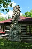 Rustic old log cabin located in Childwold, New York, United States. Rustic old traditional original log cabin located in Childwold, New York, United States on royalty free stock photography