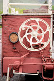 Rustic old train car connection wheel and gages Royalty Free Stock Photography