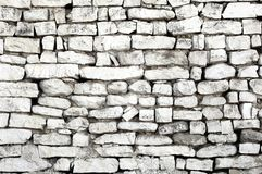 Rustic old wall with white bricks, different sizes. White stone wall made of rustic and unequal bricks. Brick wall background. Empty space, copy space, space for stock photography