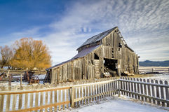 Rustic old weathered barn in the winter Stock Image