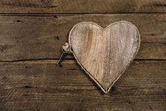 Rustic old wooden background with a key. Stock Image