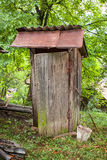 Rustic old wooden toilet Stock Images