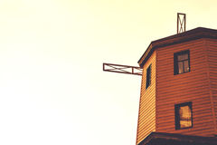 Rustic old wooden windmill against the sky Stock Photo
