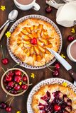 Rustic open pies with apricots and raspberry french galettes Royalty Free Stock Photography