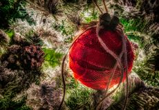 Rustic ornament made of burlap on Christmas tree. Stock Photos